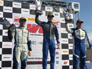 Lawson Aschenbach at the top of the Pirelli World Challenge GTS Class Podium, at the 2018 Grand Prix of St Petersburg