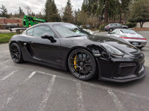 Sharkified Porsche Cayman GT4 on Forgeline One Piece Forged Monoblock GA1R Open Lug Wheels