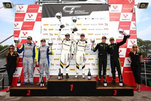 Sebastian Priaulx and Scott Maxwell at the top of the British GT podium at Oulton Park