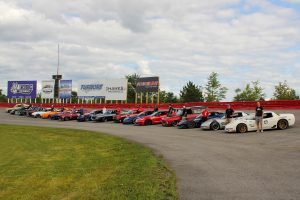 Forgeline customers lined up in front of the Forgeline billboard, at UMI Motorsports Park