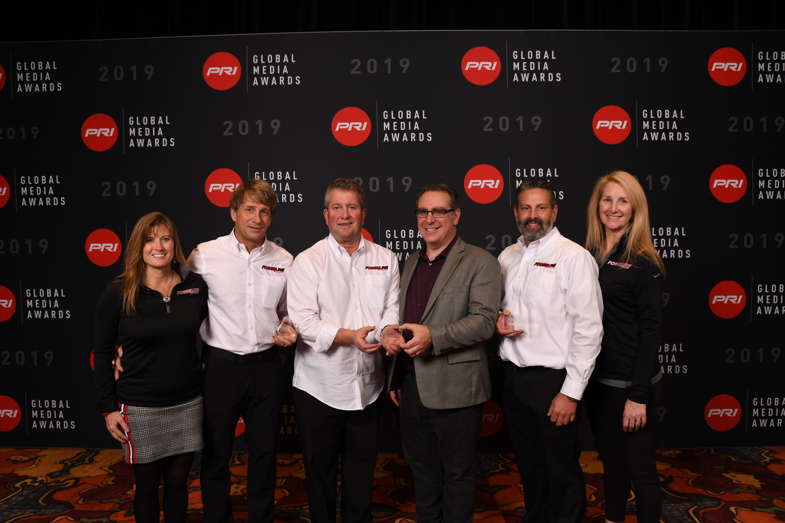 Team Forgeline accepts three Global Media Awards at the 2019 PRI Show