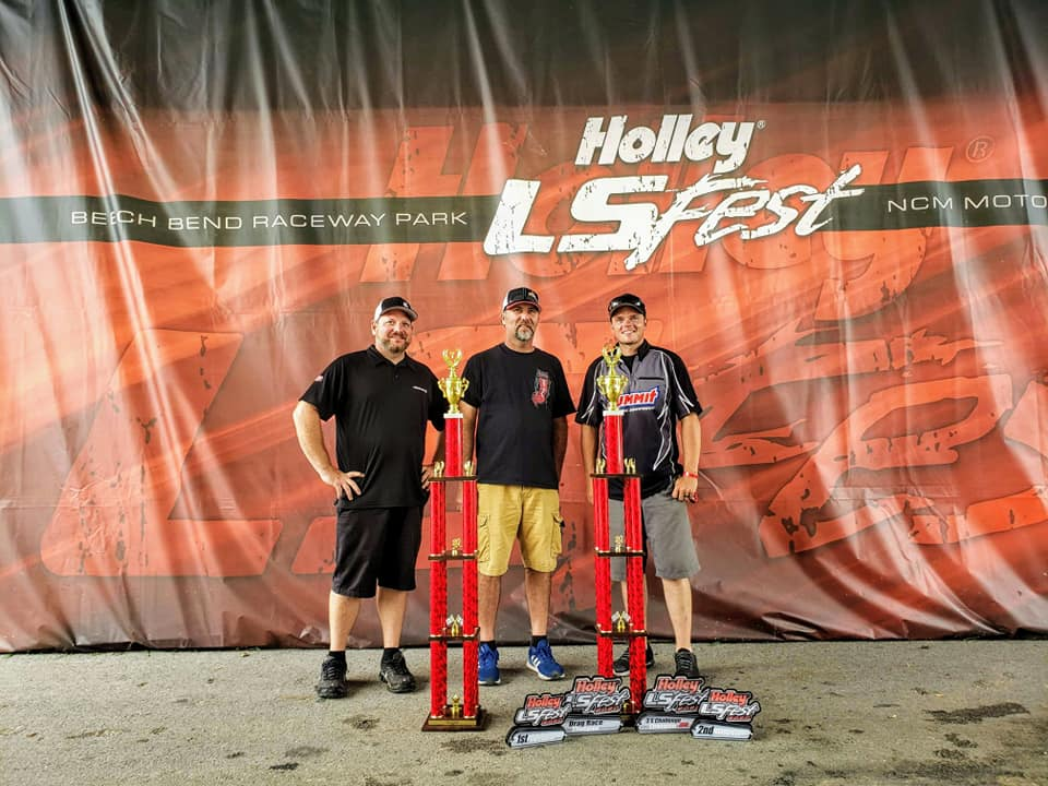 Josh Leisinger and Jason Brady receive Grand Champion trophies at the 2020 Holley LS Fest